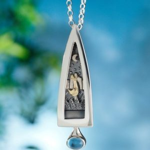 Alan Ardiff Secret Garden Pendant. Commissioned piece to celebrate the Victorian walled garden in Kylemore abbey, which can be seen through the window. Sterling silver with 18k yellow and white gold and an amethyst gemstone.
